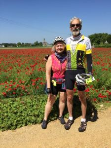 Joy + Murph in field of flowers