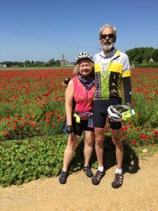 Joy + Murph in field of flowers