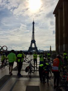 Eiffel Tower with riders in foreground